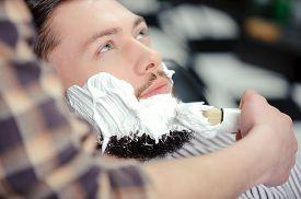 stock photo of barber razor  - Shaving the beard - JPG