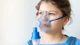 picture of respiratory  - Girl with asthma inhaler - JPG