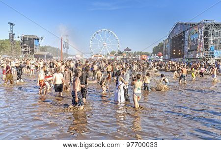 People Playing In Mud.