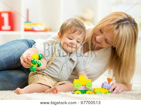 mother with her child boy play together
