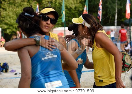 MOSCOW, RUSSIA - JULY 17, 2015: Team Brazil greeting team France after the quarterfinal match of the Beach Tennis World Team Championship. Brazil won the match 2-1