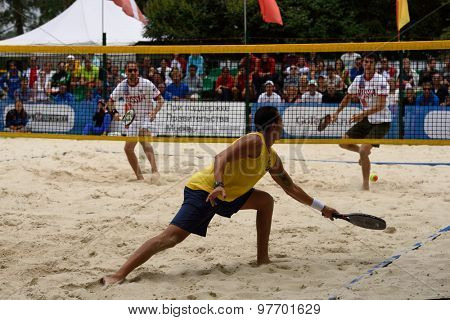 MOSCOW, RUSSIA - JULY 18, 2015: Sergey Kuptsov (left) and Nikita Burmakin of Russia, and Thales Santos of Brazil in the semifinal match of the Beach Tennis World Team Championship. Russia won 2-1