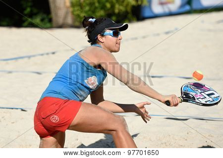MOSCOW, RUSSIA - JULY 17, 2015: Mathilde Hoarau of France in the quarterfinal match of the Beach Tennis World Team Championship against Brazil. Brazil won the match 2-1