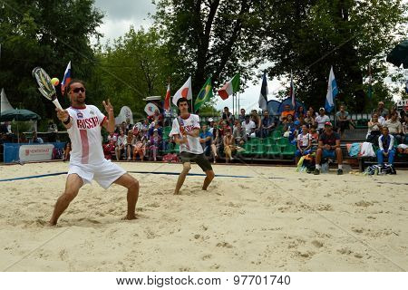 MOSCOW, RUSSIA - JULY 18, 2015: Sergey Kuptsov (left) and Nikita Burmakin of Russia in the semifinal match of the Beach Tennis World Team Championship against Brazil. Russia won the match 2-1
