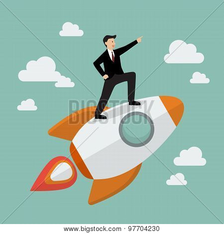 Businessman Standing On A Rocket
