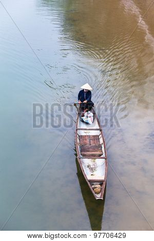 Vietnamese woman  floating on Perfume river, Hue, Vietnam.