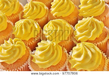 close up of frosted lemon cupcakes ready to eat