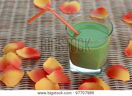 Blended Green Smoothie And Flower Petals On Table
