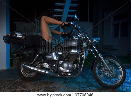 Biker Girl Sits On A Chopper Motorcycle