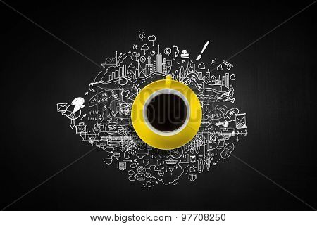 Coffee cup and business strategy sketches on black background