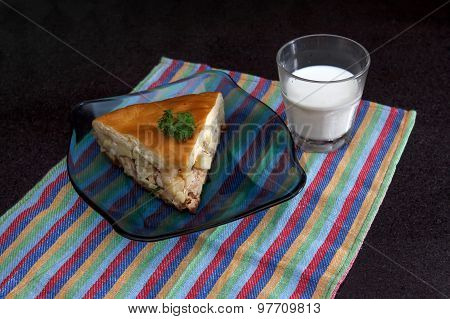 Chicken And Potato Pie Segment With Glass Of Milkt Against Black Marble Background