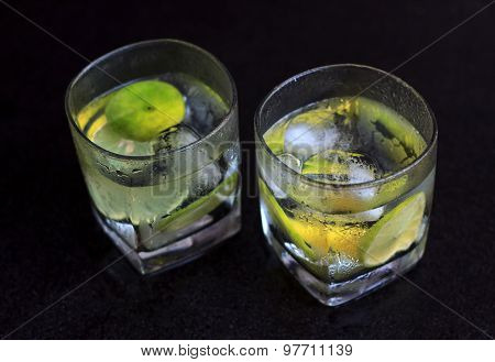 Lemonade Served On A Dark Marble Bar With A Lime