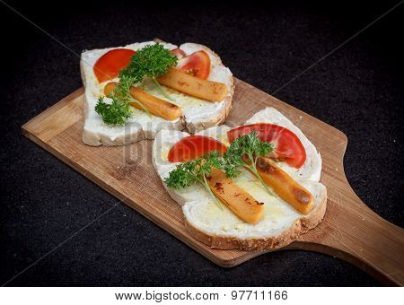 Sandwich With Fried Sausage, Tomato, Mayonnaise And Parsley