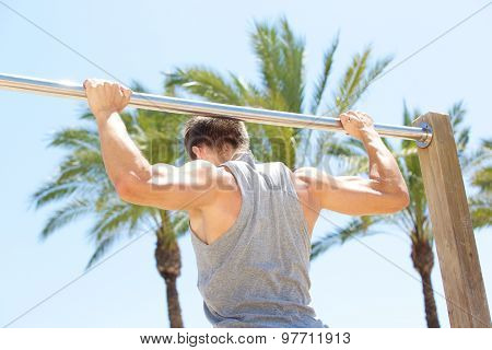 Man Holding On To Pull Up Bar