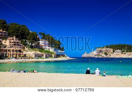 People Relaxing At The Beach In Port De Soller