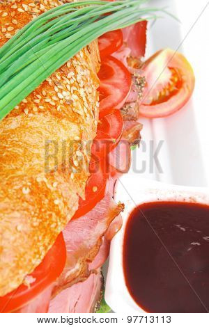 sandwich : fresh french white baguette with chicken smoked sausage on ceramic plate isolated over white background