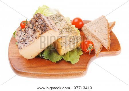 cheese and cherry tomatoes on plate over white