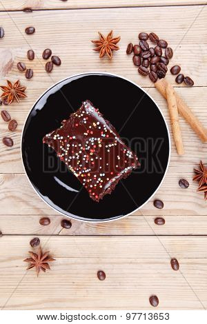 sweet food : black fragrant coffee and chocolate cake with cinnamon , coffee beans, and anise star