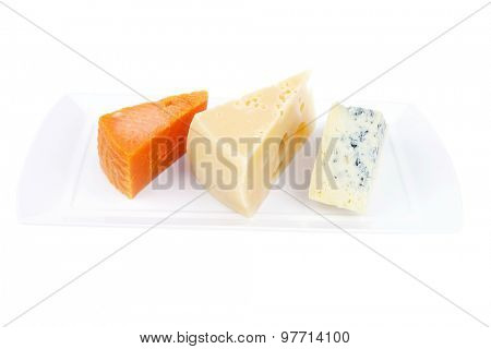 french delicatessen aged cheeses chops served on white plate isolated over white background