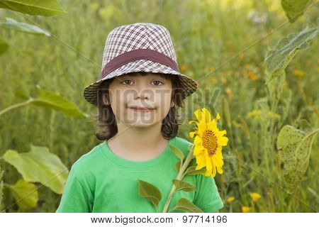 Happy boy with sunflower outdoors