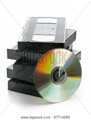 Stack Of Analog Video Cassettes With Dvd Disc