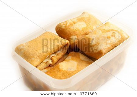 Some Pancakes With Filling In Plastic Box without cover