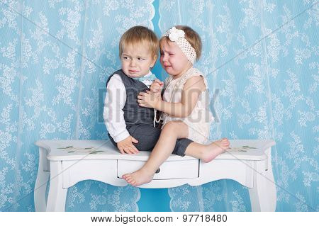 boy with girl sitting and crying