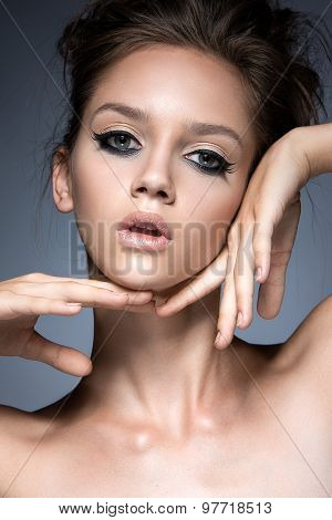 Beautiful girl with long eyelashes and perfect skin. Beauty face.
