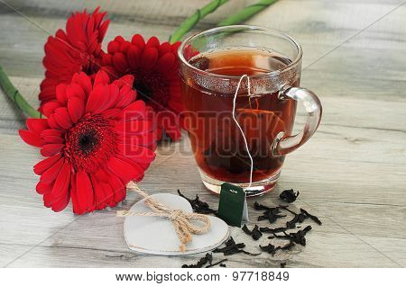 Black Tea And Beautiful Flowers