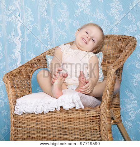 girl resting in rattan chair