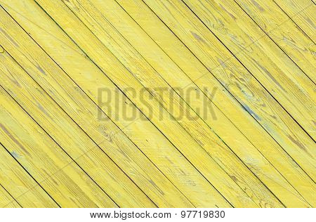 Grungy wood  diagonal planks wall texture with yellow peeling paint