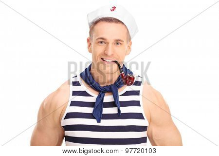 Cheerful young sailor smoking a pipe and looking at the camera isolated on white background