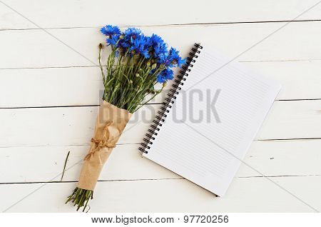 Blue Wildflowers And Memo Pad