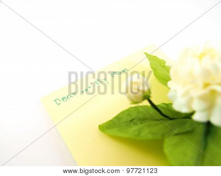 Dear My Mom, Handwriting On Sticky Note For Being Card With Blurred Handmade White Jasmin Flower, Mo