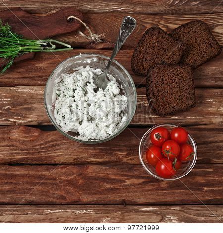 Cottage Cheese In Bowl Of Glass, Cherry Tomatoes, Dill And Bread On Wooden Background