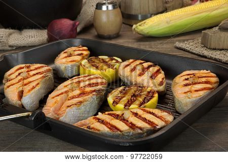 Still Life With Grilled Salmon Steaks In Rustic Style