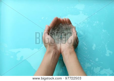 Female hands over clear water background