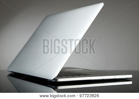 Laptop on gray background