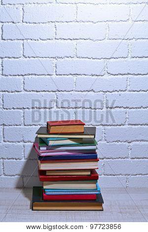 Stack of books on shelf.