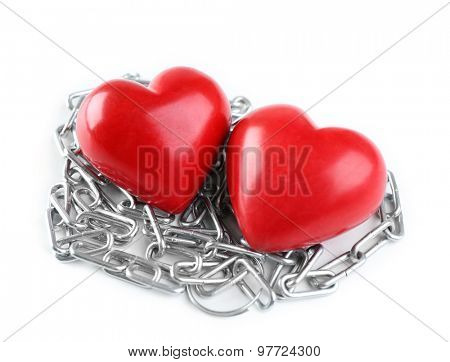 Two hearts with metal chain isolated on white