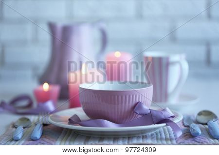 Beautiful holiday table setting in pink color