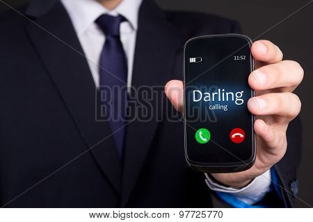 Male Hand Holding Smart Phone With Incoming Call From Darling