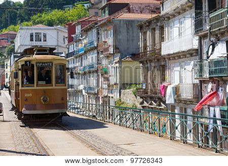 PORTO, PORTUGAL - JUNE, 14: Old tram rides in the old city at day time on June 14, 2015 in Porto, Portugal