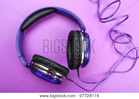 Headphones on purple background