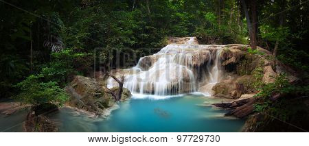Exotic tropical waterfall in green jungle forest with plants and trees of rainforest. National park beautiful nature background