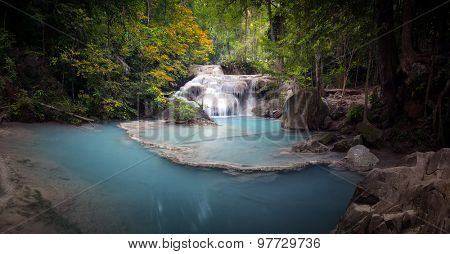 Scenic nature background of river stream flowing through green tropical forest