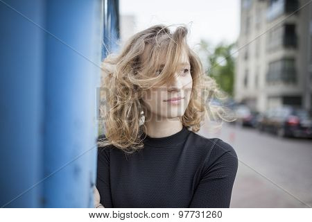 Beautiful woman with a happy expression on her face looking left