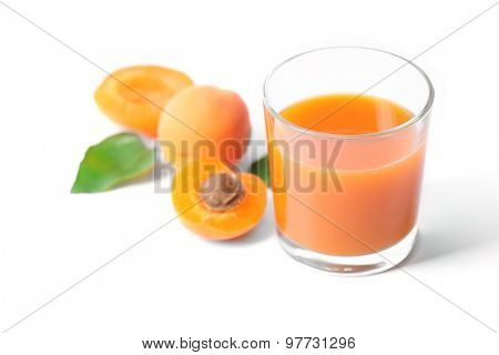 Glass of apricot juice isolated on white