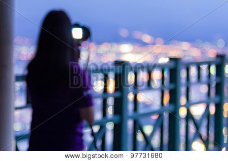 Defocused Photographer Taking Photos The City From Viewpoint