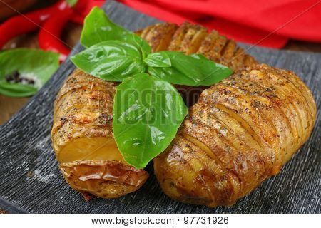 Baked potatoes in plate, closeup